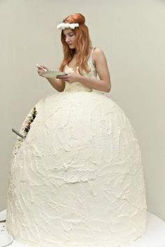 It is like those Barbie Doll cakes come to life. Yes, she is eating her wedding dress...