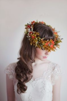 A gorgeous autumn floral crown of burnt orange, mustard, red and a hint of green. #floralcrown #fallwedding