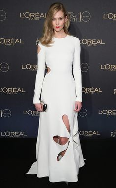 Holey moley...Karlie is STUNNING in a white long-sleeve cutout Rosie Assoulin gown.