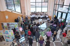 "The Huff School Honor Choir, under the direction of Kaye DeVries, perform at the ""Rethinking Green"" art show at Mountain City Hall, California."