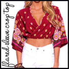 "Boho Sleeve Crop Top This cute boho flare sleeve crop top features: 100% rayon fabric which is not sheer, cross-over front, keyhole opening back, flared sleeves, and elasticized waist.                                 Measurements:                                                            Large:  shoulder-16"", bust-15"", waist-14 1/2"", length-15 1/2"" Boutique Tops"