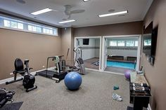 If you're resolving to improve your fitness this year, a great home gym means you have no excuses not to!  #homegym #newyearsresolution #homegymdesign #luxuryhomes