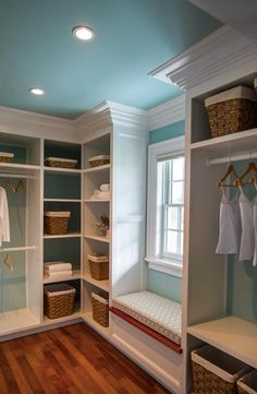 While a closet would never stay this neat (!) it's a great idea to include lots of shelving for folded sweaters, boxes of purses and shoes, and of course, a bench to sit on.