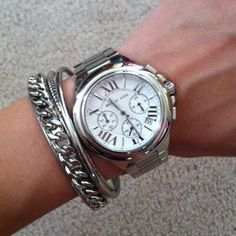 Michael Kors chronograph boyfriend watch in silver tone.  A few links removed but they are included to re-size.  NWOT, no scratches or damage, never worn.