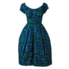 1950's Michael Novarese Blue & Green Floral Garden Print Silk Party Dress | From a collection of rare vintage evening dresses at http://www.1stdibs.com/fashion/clothing/evening-dresses/