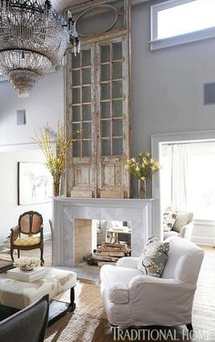 How fantastic is this antique door on the mantle, adds such height! via Traditional Home