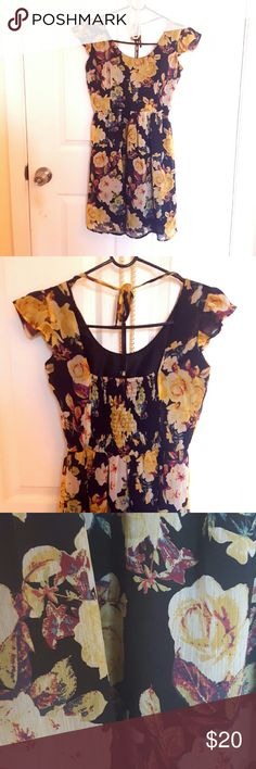 American rag floral short sleeve dress Flowing floral knee length short sleeve dress- ties in back to keep it from slipping down your shoulders. Delicate floral/rose pattern on black. I love to wear this with heels and pearls for fancy occasions or with tights and chunky accessories for day to day wear. American rag size XS. In like new condition, worn a few times. American Rag Dresses