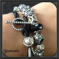 PANDORA Bracelet Stack Featuring Silver and Black Lariat.