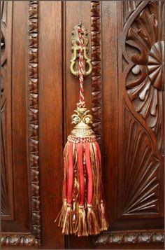 Design Tip: Tassels make great adornment detail for keys on antique furniture.