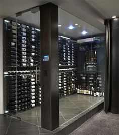 Inside view of a stunning VintageView glass-enclosed showcase home wine cellar