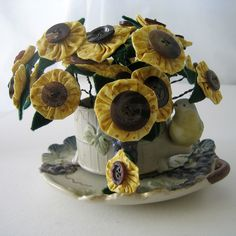 sunflowers/ looks like they are made with a yo yo and a brown button