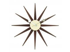 George Nelson Walnut Finished in. Sunburst Walnut Clock - The minimalistic charm of the George Nelson Walnut Finished in. Sunburst Walnut Clock makes it a true classic, as stylish as ever. The warm.