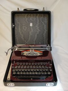 1930's Maroon LC Smith Corona Silent Typewriter with case and cleaning brush