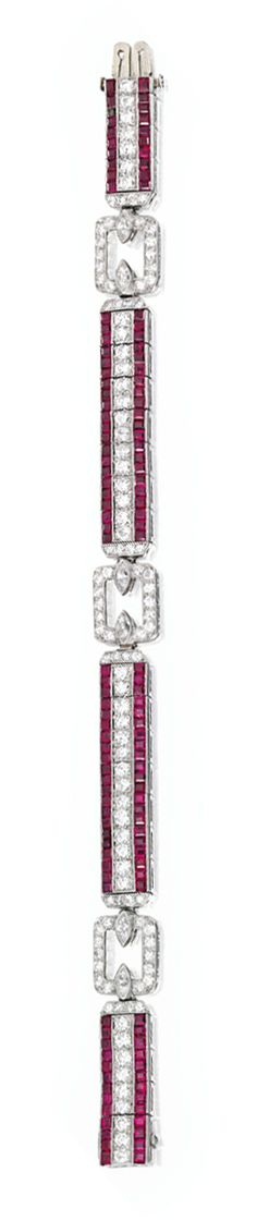 PLATINUM, DIAMOND AND RUBY BRACELET, TIFFANY & CO.  Estimate: 20,000 - 30,000 USD   Set with round and marquise-shaped diamonds weighing approximately 4.95 carats, bordered by 130 calibré-cut rubies, length 7¼ inches, signed Tiffany & Co.; circa 1930.