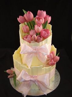 White chocolate wrap with gumpaste tulips. Lovely work, now to see if I can find out who made it and give them credit.