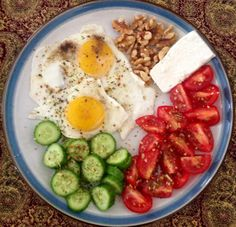 My Persian Breakfast. Sunny side eggs, cherry tomato, Persian cucumber, walnuts and Tabriz cheese.