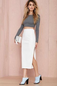 You need this perfectly pleated vegan leather skirt by Maurie & Eve in your life ASAP.