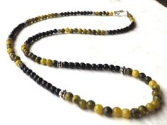 Hey, I found this really awesome Etsy listing at https://www.etsy.com/listing/210850482/mens-necklace-onyx-and-yellow-turquoise