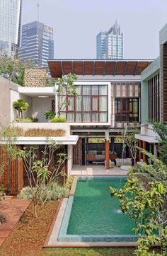 Contemporary single family house located in Jakarta, Indonesia, designed by Atelier Cosmas Gozali. Beautiful Blinds, Beautiful Homes, Beautiful Places, Lakefront Homes, Inspired Homes, Glass Design, Modern House Design, Building Design, Modern Architecture