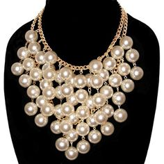 59 18mm pearls and 2 rows of gold plated vintage chain, go into the making of this gorgeous necklace! Handmade in our New York workroom! And available only from GirlPROPS! $50  Looks like the one from Two Broke Girls.