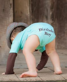 Baby Boy First Birthday Outfit!!! Might just have to get this!! Would have to add some matching baby legs tho!!  I thought it was cute when I saw the front of it, but now that I see the bum I agree. Add baby legs if husband will agree to one last baby legs hurrah!