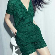 Emerald green lace romper Stunning lace romper with crossover front and zipper back. Sized 0 but can fits more like a 2/4 in my opinion Chelsea 28 Pants Jumpsuits & Rompers