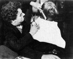 Charlie Chaplin playing the Barber