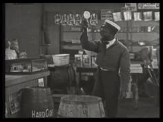 145. The janitor offers to toss up a teacup. | Fast and Furious (1924)
