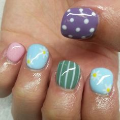 Baby blue, green, baby pink,  and purple shellac nails with polka dots, pinstripes, and daisies. Instagram: @boop711