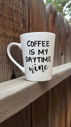 Coffee is my daytime wine Personalized 14oz ceramic mug. Your choice of vinyl color. *Multiple vinyl colors available. Please add the color youd like to the notes to seller when ordering. *made with high quality permanent outdoor vinyl *Glitter can be added to the handle for an additional charge of $2. Multiple glitter colors available *All glitter is sealed and will not shed *All items are made when ordered *This is a picture of what your item will look like. Due to each one being created…