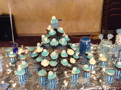 Blue and white frosted cupcakes with sugar snowflakes that I found on Amazon... Shimmery white and blue sugar sprinkles made it fun!