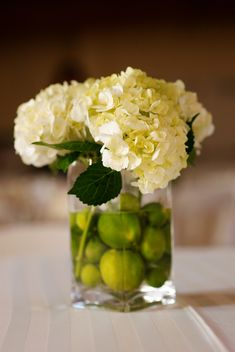 Like the concept of putting lemons or limes in the arrangement as well as the flowers although it does seem like it's wasteful.