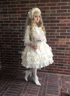 Beautiful white Lolita dress with lots of bows and lace. With a vintage touch.
