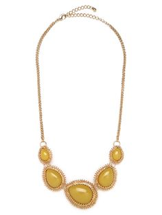 We're mad for the effortless glamour at the heart of this striking style. The necklace features gorgeous teardrop cabochon gems, in beautiful sun yellow, and each comes luxely framed in glittering gold.