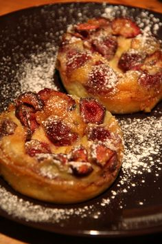 ??CALFOUTI OR a baked French dessert of fruit, traditionally black cherries, arranged in a buttered dish: Cherry Clafoutis