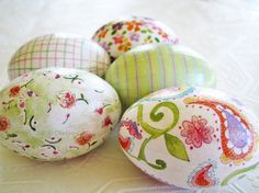 decoupage eggs for easter; done with scrapbook paper and regular school glue