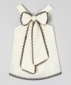 This darling dress combines oh |