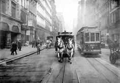The last of the Horse Drawn Carriages, side by side with an electric tram in New York; 1917.