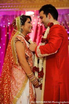 a-indian-wedding-ceremony-tradtional-mandap-fabric-bride-and-groom-jai-mala3