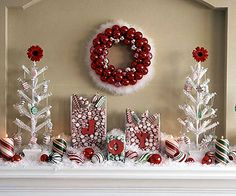 Party-Time Peppermint ~ A cohesive red-and-white color scheme pulls together glass vases filled with peppermints and simple white trees adorned with glass faux-candy ornaments.