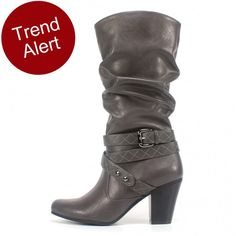 Slouch style boot with full zip, featuring a crisscross strap with diamond stitching pattern. Buckle and rivet accents. Add this stylish scrunch boot to your must-have list for Fall 2014! The quilted wrap-around buckled strap will surely draw all the attention you need.  Rialto Shoes Glendale Grey Boot Rialto