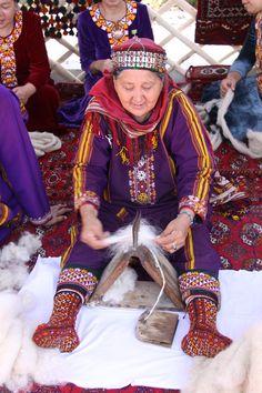 Turkmen woman combing wool fiber