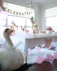 Jellycat plush swan overlooks first birthday swan princess party decor