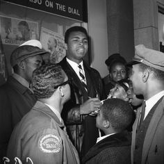 Muhammad Ali signs autographs at Hotel Theresa in New York City on June 24, 1964. Muhammad, was rejected by the Army the day before.