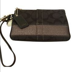 Coach wristlet with silver stripe Excellent condition except for wear on strap. No trades or offline transactions. Reasonable offer via offer option only. Coach Bags Clutches & Wristlets