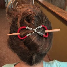 Twisted up-do held by a bright red braided genuine leather hair stick accessory from Lilla Rose. 'Band & Bolos'