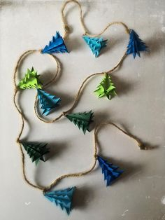 Items similar to Christmas Garland Rustic Christmas Tree Origami Decoration on Etsy Wooden Christmas Decorations, Rustic Christmas, Christmas Crafts, Christmas Ornaments, Handprint Christmas Tree, Origami Christmas Tree, Origami Garland, 242, Diy Weihnachten