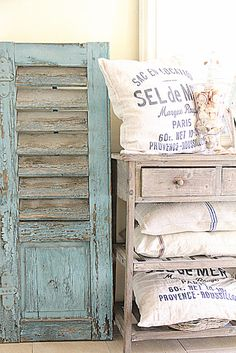 Chipped & Peeling...old blue shutter...distressed painted cabinet...with french muslin pillows...shabby chic.
