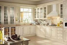I want cupboard doors like this for my kitchen, the little windowed doors are amazing.