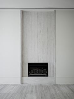 Modern stone fireplace at Walsh Street Apartments designed as two bespoke homes in South Yarra